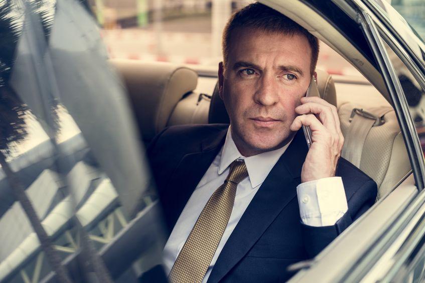 Businessman Talking Using Phone Car Inside